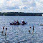 Auf dem Wasser aktiv mit Kindern in Mecklenburg-Vorpommern: Glasboden Kanu und Seerosenblüte